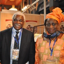 Ms. Chii Akporji, the Alliance's Communications Officer, with a visitor to the Cities Alliance booth.